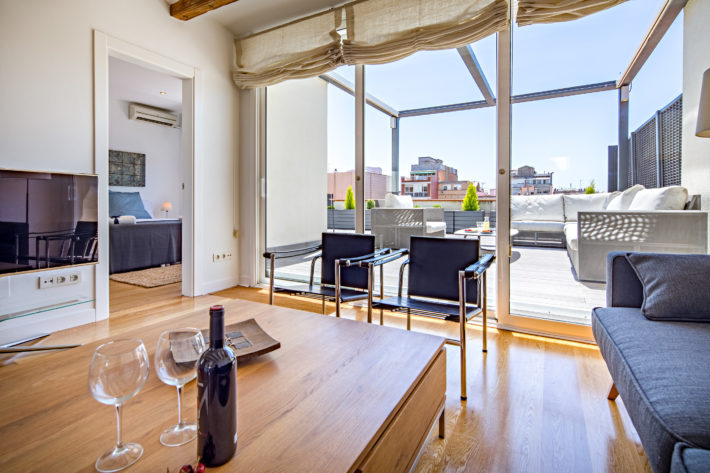 boulevard attic apartment barcelona living room view 5 e1525702390878 Perfect Apartments for Summer Holiday in Barcelona